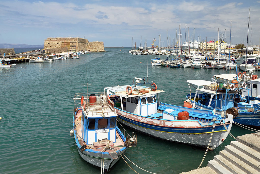 Fishing boats and marina in the old harbour of Heraklion at the north coast of Crete in Greece.